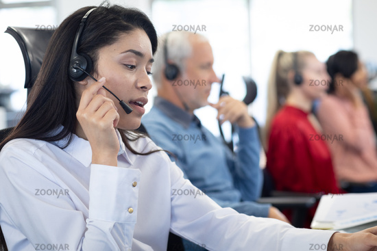 Businesswoman wearing headset working at office