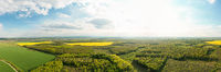 Scenic landscape of countryside from bird's eye view, springtime. Aerial drone view