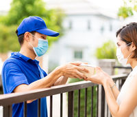 Asian deliver man handling package delivery to female customer woman.