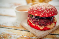 Beetroot burger on shabby table