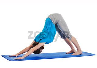 Yoga - young beautiful woman yoga instructor doing Downward Facing Dog (adho mukha svanasana) asana exercise isolated on white background