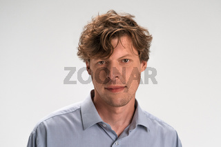 Nice-looking attractive guy isolated on light white pastel background. Closeup photo of amazing friendly guy perfect neat appearance hairstyle. Studio portrait