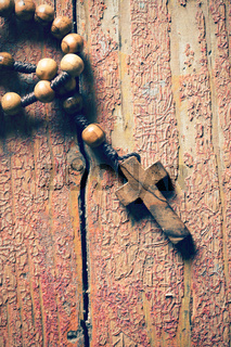 rosary on old wooden table