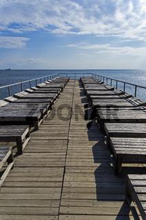 Empty beach terrace with sun beds.