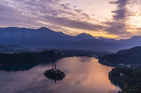 Aerial view of the Bled island and castle at sunrise