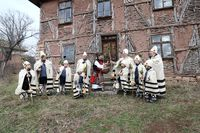 Festive holiday carols circumnavigate the houses of Bov village and sing Christmas songs.