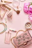 Fashion women stylish accessories outfit composition. Pink pastel background with copy mock up space