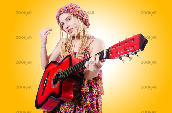 Guitar player woman isolated on white