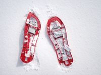 Winter hiking in the mountains on snowshoes with poles and  backpack. Winter walk