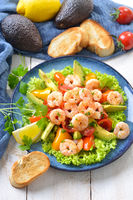 Delicious avocado tomato salad with fried prawns