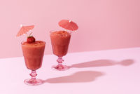 Strawberry smoothie. Two glasses of berry slush. Summer cold drink