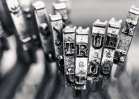 the word TRUE with old typewriter