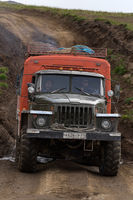Off-road extreme expedition truck Ural driving on mountain road, transportation travelers in direction travel destinations