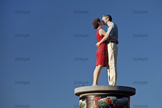 stylite couple II on an advertising column, Duesseldorf, North Rhine-Westphalia, Germany, Europe