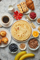 Various breakfast ingredients placed on stone table