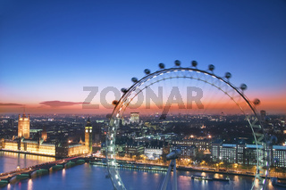 Houses of Parliament and London Eye at dusk