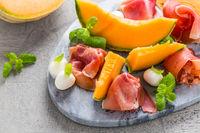 Traditional Italian appetizer - Prosciutto with cantaloupe melon