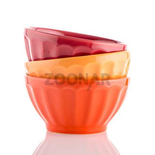Three colored bowls