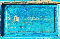 Wooden texture with frame and flaking old blue paint