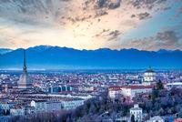 Turin panoramic skyline at sunset with Alps in background