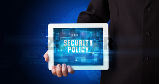 Person holding tablet, security concept