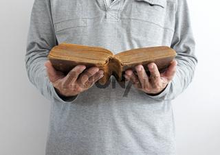 man reading old bible