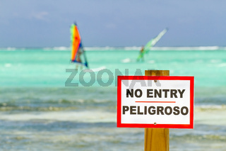 No entry sign in sea with windsurfers