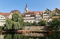 City View of Tuebingen from River Neckar with Monastery Church St. George, Germany