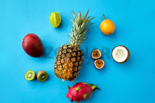 pineapple with other fruits on blue background