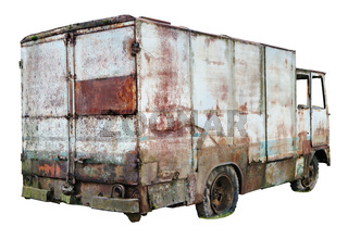 Decayed rusty nameless car van for transportation of agricultural products and bread thrown in the forest isolated