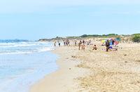 People on the sandy beach of Los Arenales del Sol, Spain