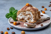 Piece of meringue coffee roulade.