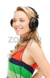 happy teenage girl in big headphones