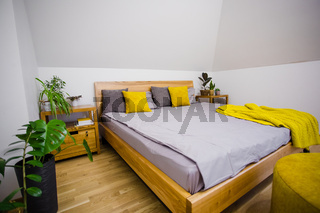 Cosy uncluttered bedroom only with essential things