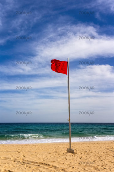 Beach with red flag