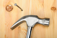 An image of a hammer with nail