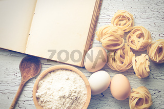 tagliatelle pasta with cookbook