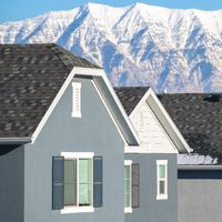 Square frame Traditional American houses against mountain range day light