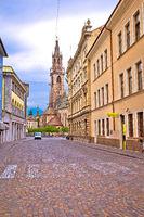 City of Bolzano empty old street and church view