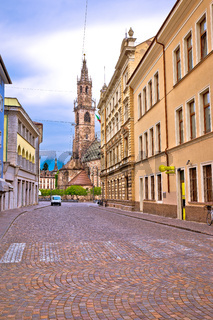 City of Bolzano empty old street and church view