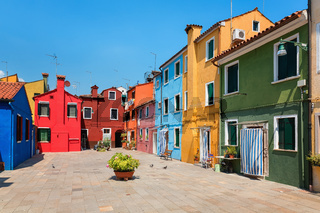 Colorful houses in a row on the Venetian island Burano