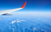 Plane wing on the background of Western Caucasus mountains. Adygeya, Russia.