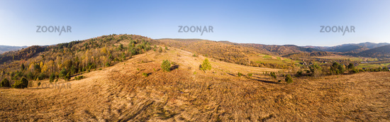 Aerial drone view 180 degrees panoramic scenic landscape of mountains and forests, slopes and valley