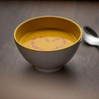 Vegetarian autumn - Pumpkin cream soup with hearth decoration