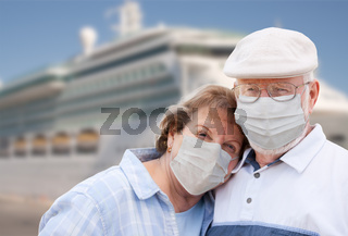 Senior Couple Wearing Face Masks Standing In Front of Passenger Cruise Ship
