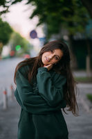 Portrait of cute girl with long hair looks at the camera