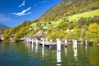 Alpnachstad Swiss Alps village on Luzern lake boat pier and landscape view