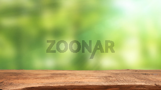 Abstract spring background with flares and a wooden table