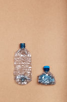Squashed empty plastic bottles put in a row