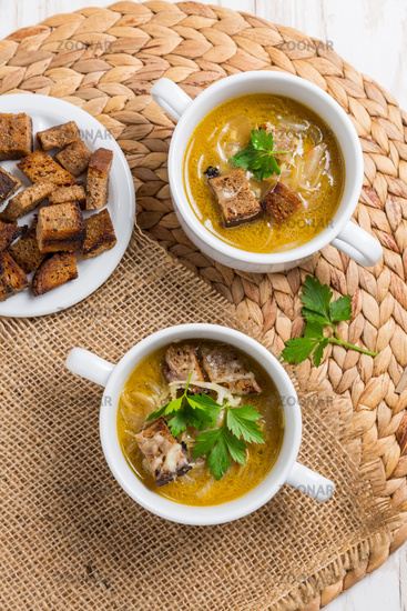 Traditional French onion soup with toasted bread croutons for autumn and winter